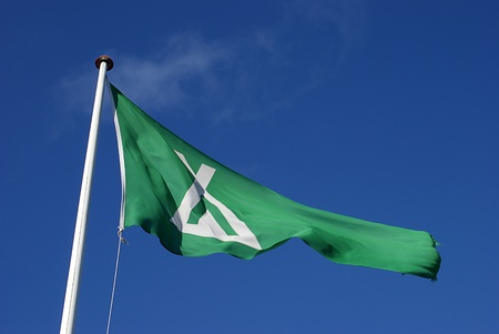 Camping flag waving aginst blue sky Stock Photo - 12874650