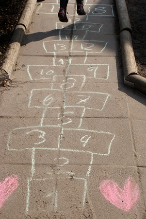 Playing on a hopscotch lane with hearts Stock Photo
