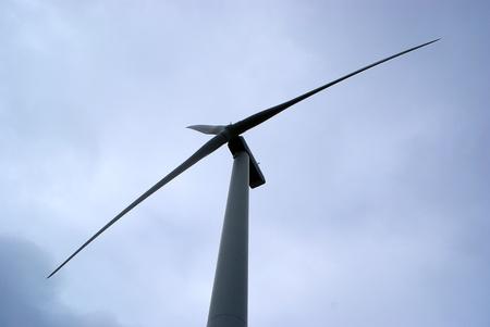 Wind turbine tilted against the sky