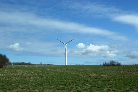 Landscape with clouded sky and wind turbine Stock Photo - 13122297