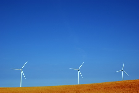 Three wind mills standing in red soil Stock Photo - 13276271