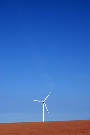 Wind turbine on colourful soil Stock Photo - 13276089