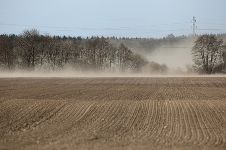Dust storm over fields