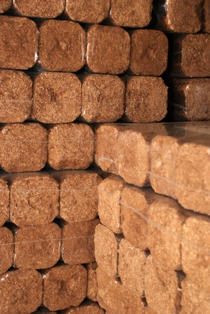 briks: Hard wood briks for heating Stock Photo