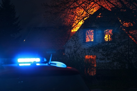 fire car: House on fire with rescue car arrived Stock Photo