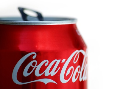 Dry, open, cocacola can in golden light.  Editorial