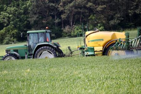 Farmer spraying his field