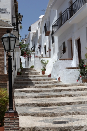 Small street in Andalusian mountain village Frigiliana, Spain Stock Photo - 14392730