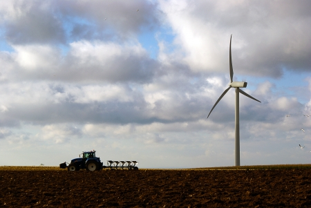 vestas: Danish agricultural landscape with tractor plowing and windturbine