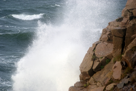 Spray of waves against cliffs photo