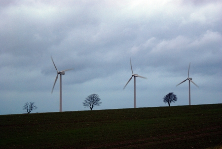Three windturbines in darkening clouds Stock Photo - 14970626