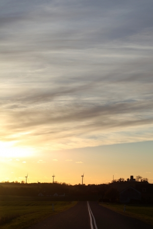 countrysides: Danish evening landscape with windturbines and country church in silhouette