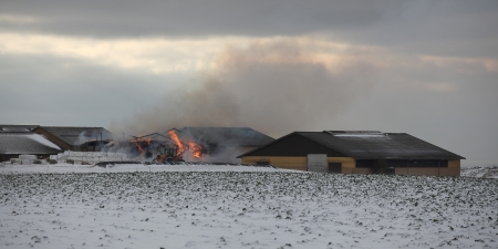 ignited: Fire at farm. Straw ignited in stable.
