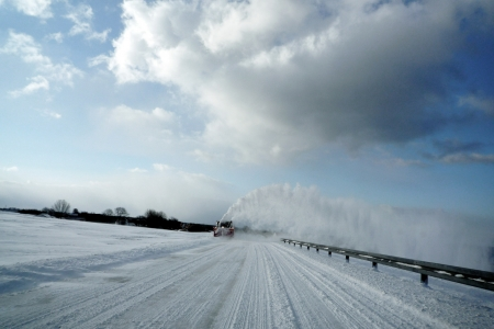 Snowblower clears the road  Clouds and snow  Denmark  photo