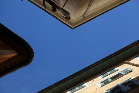 Looking up where small steets meet in Nice. France. photo