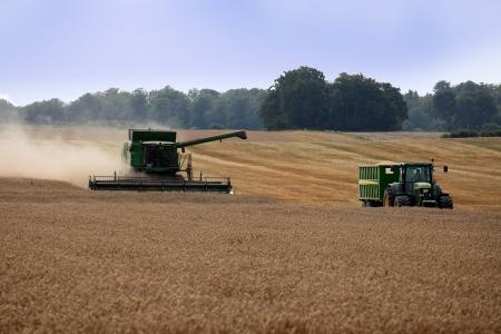 Harvester near tractor waiting for grain