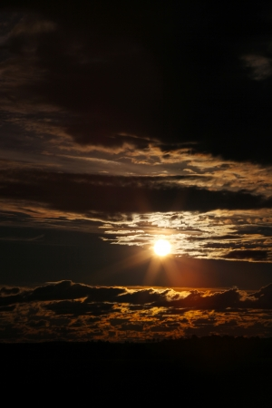 The sun. A dramatic sky where clouds give way for sunshine.