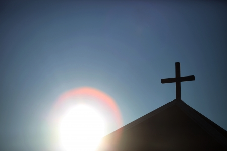 Symbolic sun and chapel with wooden cross