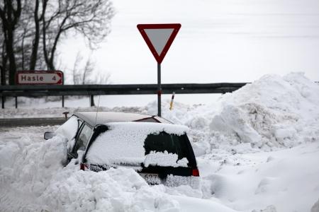 snowbank: Snowbank at road stops car. Stock Photo