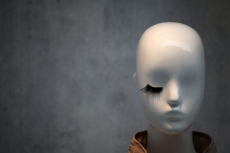 department head: White mannequin head with one black eyelash  Stock Photo