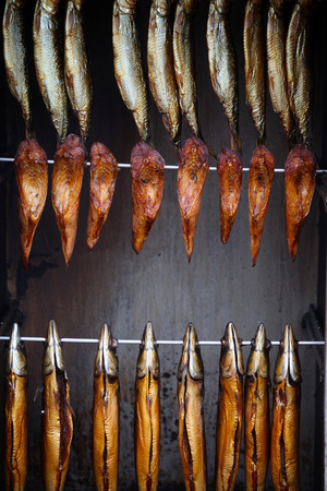 Smoked fish steaks on spits. Stock Photo