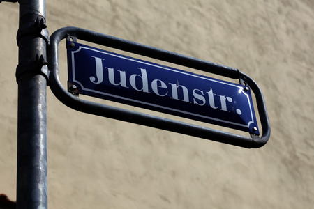persecution: Historic street sign from Germany Stock Photo