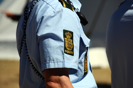 Police sign on police officers shirt