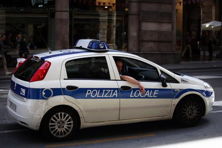 patrolling: Local police car patrolling  Italy