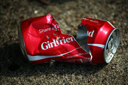 Broken coke can illustrates the end of a summer love story Editorial