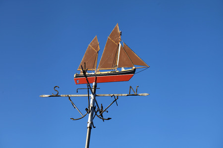 Ship weather vane pointing north.