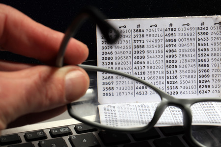 Hard reading digit code on the NemID card. Putting on the glasses.