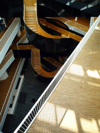 The famous staircase inside UN City Copenhagen inspired by Harry Potter and a Grand Piano. Architects 3XN Editorial