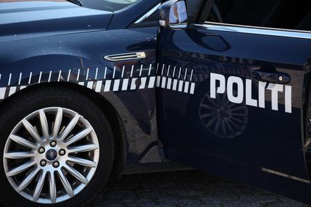 Police car in bright daylight. Door open. Stock Photo