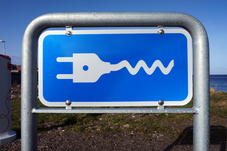 Street sign for electrical cars. Refueling the modern vehichle.