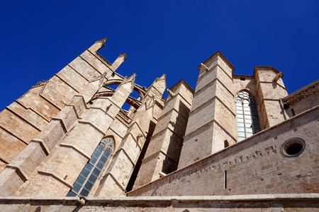 La Seu, Palma de Mallorca - the cathedral pointing up to the clear blue sky.