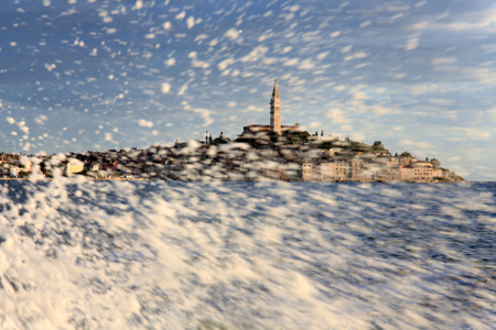 Sea Spray in front of Rovinj, an old Picturesque town in Istria Croatia Stock Photo