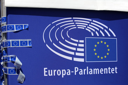 EU-parlament logo held tight by some adhesive tape Stock Photo - 116661103