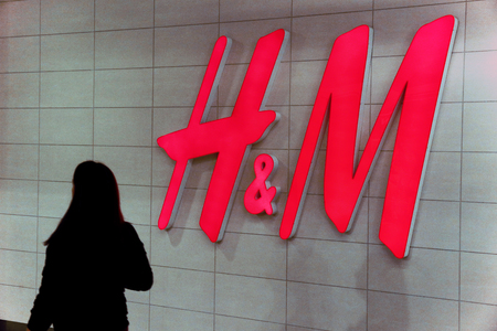 Logotype H M, swedish Hennes & Mauritz Brand at wall of store in clothing shop. A world wide clothes shop or clothes store. Publikacyjne