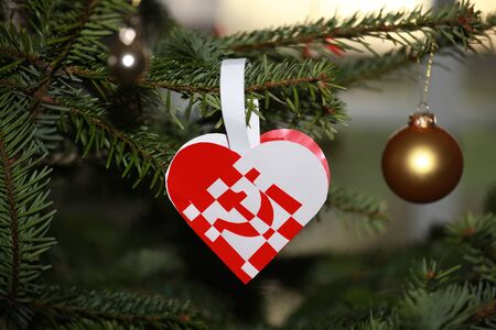 Christmas heart with protest on capitalism. Hammer and sickle. Stock Photo