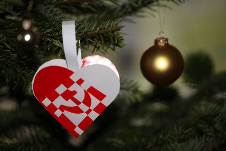 Christmas heart with protest on capitalism. Hammer and sickle.