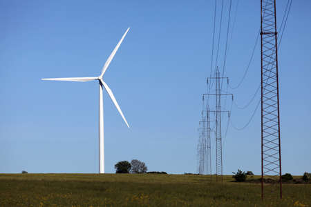 A wind turbine and high voltage power line Stock Photo