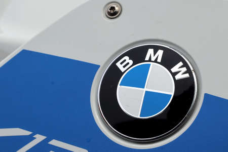 BMW logo on motorcycle in blue and white colors. BMW is characterized by clean driving range, high comfort and powerful lines. Editorial