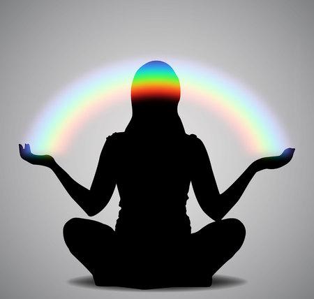 Silueta de una niña sentada en una pose de loto con arco iris