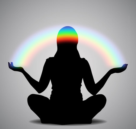 Silhouette of a girl sitting in a lotus pose with rainbow