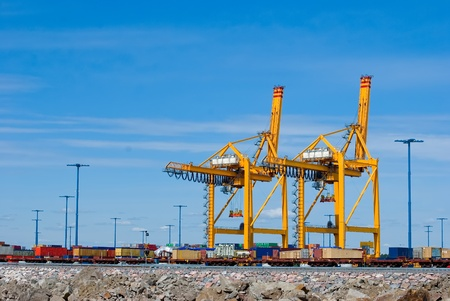 Containers loading at sea trading port Stock Photo - 12489066