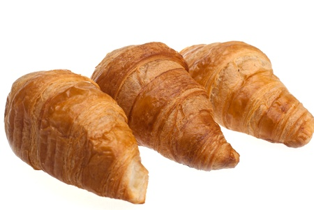 The traditional French croissants on a white background. Stock Photo