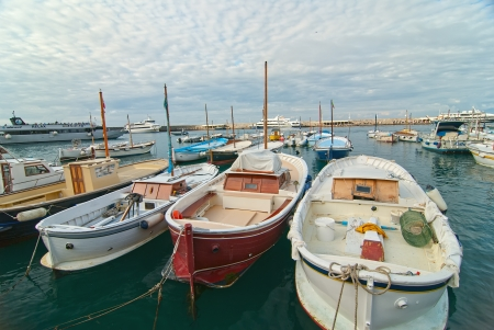Fishing boats in port on the island of Capri  photo