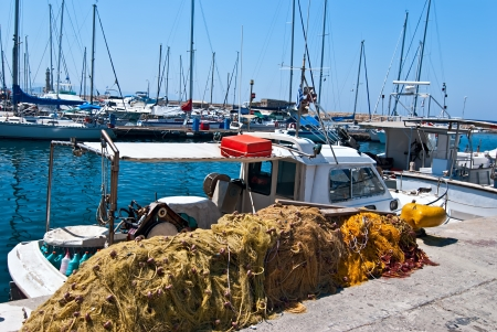 Traditional Greek fishing boat moored in the port city of Chania  Crete  photo