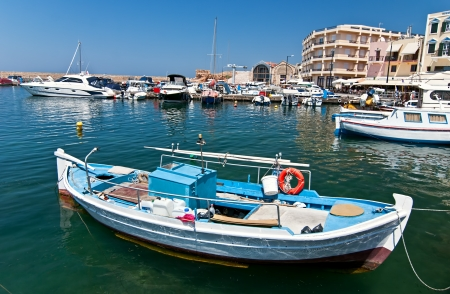 Greek fishing boat moored in the port city of Chania  Crete  Stock Photo