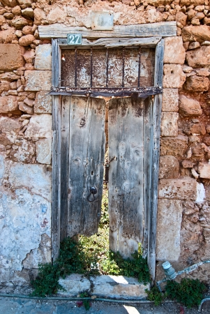 Old door in the winding alleys of the city of Chania  Crete  photo